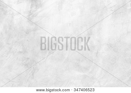 Abstract weathered texture stained old stucco light white and aged paint concrete wall background in the room. stock photo