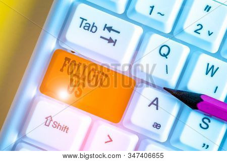 Word writing text Follow Us. Business concept for To invite a demonstrating or group to join his company and take rules White pc keyboard with empty note paper above white background key copy space. stock photo