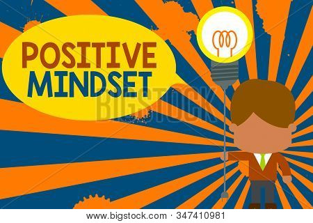 Conceptual hand writing showing Positive Mindset. Business photo text mental attitude in wich you expect favorable results Standing man tie holding plug socket light bulb Idea Startup. stock photo