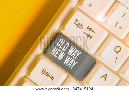 Conceptual hand writing showing Old Way New Way. Business photo text The different way to fulfill the desired purposes White pc keyboard with note paper above the white background. stock photo