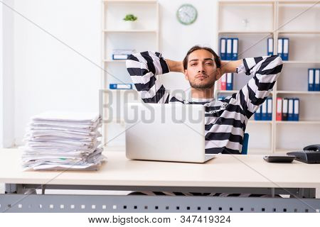 Young employee feeling like prisoner at work stock photo