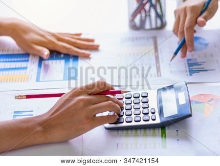 Business people meeting to analyze and discuss the situation on the financial report in meeting room. Meeting planning budget and cost. Business financial analysis and strategy concept. stock photo