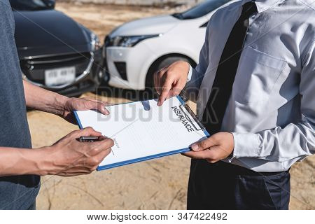 Insurance Agent and customer assessed negotiation, checking and signing on report claim form process after accident collision, Traffic Accident and insurance concept. stock photo