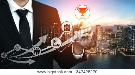 Achievement and Business Goal Success Concept - Creative business people with icon graphic interface showing employee reward giving for business success achievement. stock photo