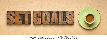 set goals banner in letterpresss wood type with a cup of coffee, goal setting and resolutions concept stock photo