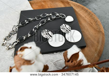 Silver handmade jewelry for women. Heart-shaped pendant on a silver chain. Decorations for Valentines Day. chains on a wooden background. View from above. stock photo