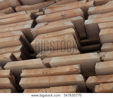 Wooden planks. Air-drying timber stack. Wood air drying (seasoning lumber or wood seasoning). Timber. Lumber. Close-up. stock photo