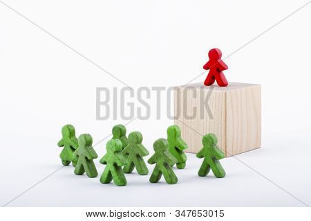 Successful team leader (manager, CEO, market leader) and another business leading concepts. Standing out from the crowd. Leadership concept. stock photo