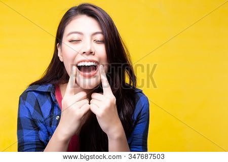 Beautiful woman has beautiful tooth, white teeth, nice tooth alignment. Attractive beautiful young lady take care of teeth very well. She get her teeth cleaned. Pretty girl show her teeth. copy space stock photo