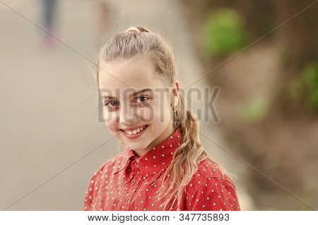 Innocence and purity concept. Tender small kid smiling beautiful face. Happiness and joy. Toothy smile. Little child happy smile. Smiling kid with healthy teeth. Adorable girl sincere smiling. stock photo