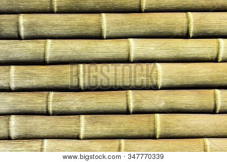 Brown long bamboo sticks pattern. Natural horizontal wooden plant pipes background. Asian natural jungle fence background. stock photo