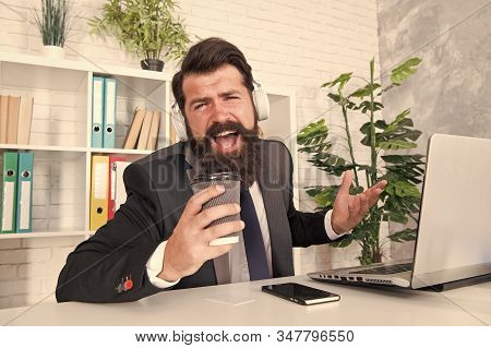 Singer or manager. Office manager sing karaoke using coffee cup. Manager enjoy singing during coffee break. Project manager make music fun in office. stock photo