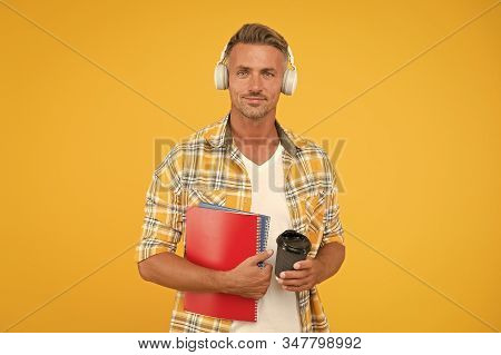 Never too late to study. Educational technology. Study again. Audio book concept. Worldwide knowledge access. Audio library. Another way of study. Man handsome college student headphones books. stock photo