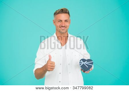 Best Valentines Day. valentines day shopping. best present here. happy holiday celebration. mature man thumb up gesture. heart gift box. the best shopping online. handsome man buy gift for girlfriend stock photo