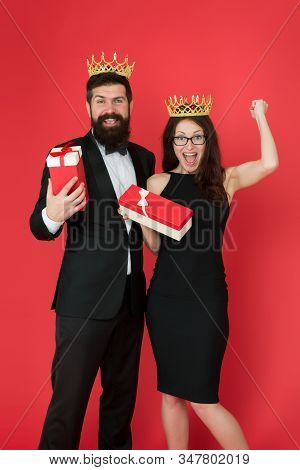 Gifted for achievements. Pride and pleasure. Successful and proud. Victory and triumph. Success goal. Beautiful people celebrate success. Couple in love wear crowns red background. Enjoying success. stock photo