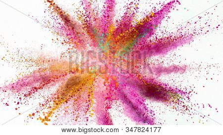 Explosion of colored powder isolated on white background. Abstract colored background stock photo