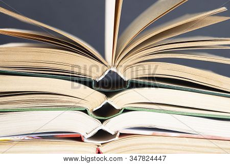 A simple composition of hardback books, raw books. Open books. Stacking books without inscriptions, empty spine. Back to school. Open book stock photo