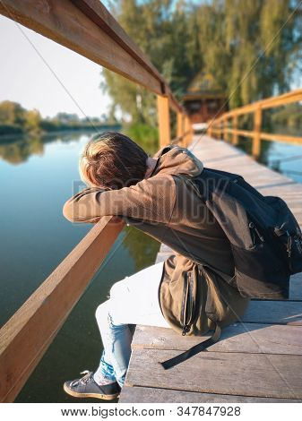 Women experience life problems sitting alone on the bridge.woman sad alone stock photo