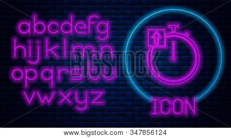Glowing neon Stopwatch icon isolated on brick wall background. Time timer sign. Chronometer sign. Neon light alphabet. Vector Illustration stock photo