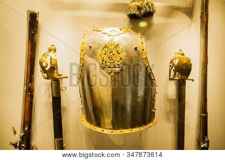 Knight in armor. Medieval helmet. Metal protection of warrior. Soldier in armor protection. Steel shield. Medieval sword stock photo