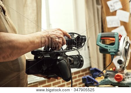Video production backstage. Behind the scenes of creating video content, a professional team of cameramen with a director filming commercial ads. Video content creation, video creation industry. stock photo
