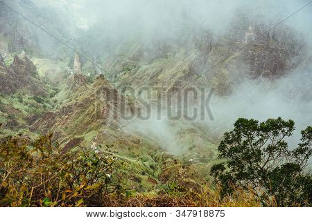 Santo Antao Island at Cape Verde. Ribeira da Torre located in fertile Xo-xo valley. Scenic landscape of bluff green mountain slopes and misty clouds stock photo