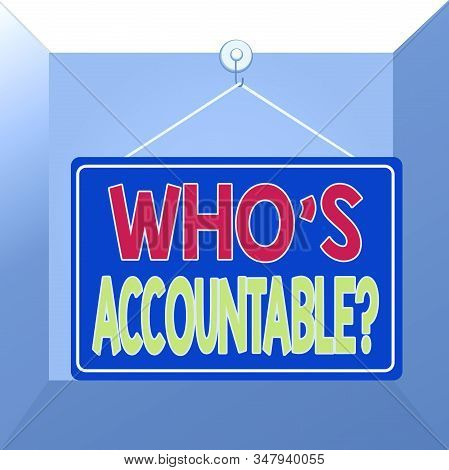 Conceptual hand writing showing Who S Accountable. Business photo showcasing answerable for something within one power or control Memo reminder empty board attached background rectangle. stock photo