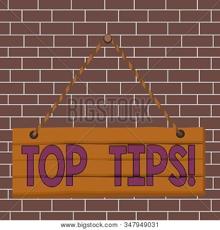Text sign showing Top Tips. Conceptual photo small but particularly useful piece of practical advice Wood plank nail pin string board colorful background wooden panel fixed. stock photo