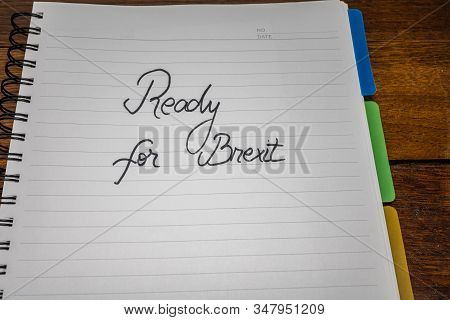 Ready for Brexit, handwriting  text on paper, political message. Political text on office agenda. Concept of democracy, voting, politics. Copy space. stock photo