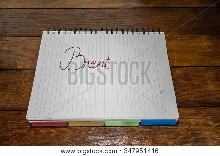 Brexit (January 31, 2020) handwriting  text on paper, political message. Political text on office agenda. Concept of democracy, voting, politics. Copy space. stock photo