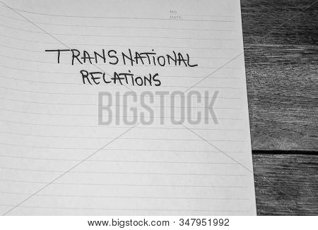 Transnational relations, handwriting  text on paper, political message. Political text on office agenda. Concept of democracy, voting, politics. Copy space. stock photo