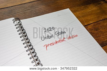 2020 Unites States, presidential election, handwriting  text on paper, political message. Political text on office agenda. Concept of democracy, voting, politics. Copy space. stock photo