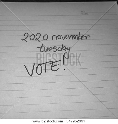 2020 november, tuesday vote (USA presidential election) handwriting  text on paper, political message. Political text on office agenda. Concept of democracy, voting, politics. Copy space. stock photo