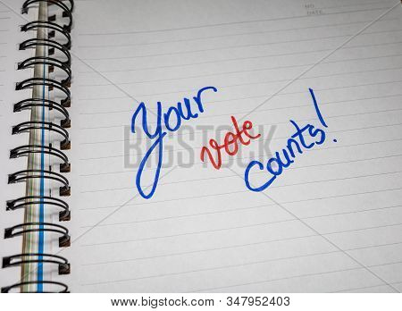 Your vote counts, handwriting  text on paper, political message. Political text on office agenda. Concept of democracy, voting, politics. Copy space. stock photo