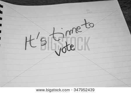 It`s time to vote, handwriting  text on paper, political message. Political text on office agenda. Concept of democracy, voting, politics. Copy space. stock photo