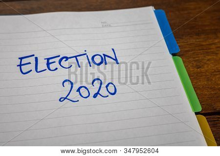 Election 2020, handwriting  text on paper, political message. Political text on office agenda. Concept of democracy, voting, politics. Copy space. stock photo