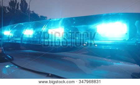 Paramedics arrive at accident place, emergency lights on ambulance auto closeup stock photo