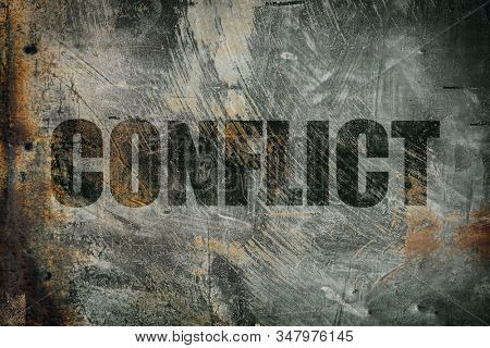 Conflict written on steel background stock photo