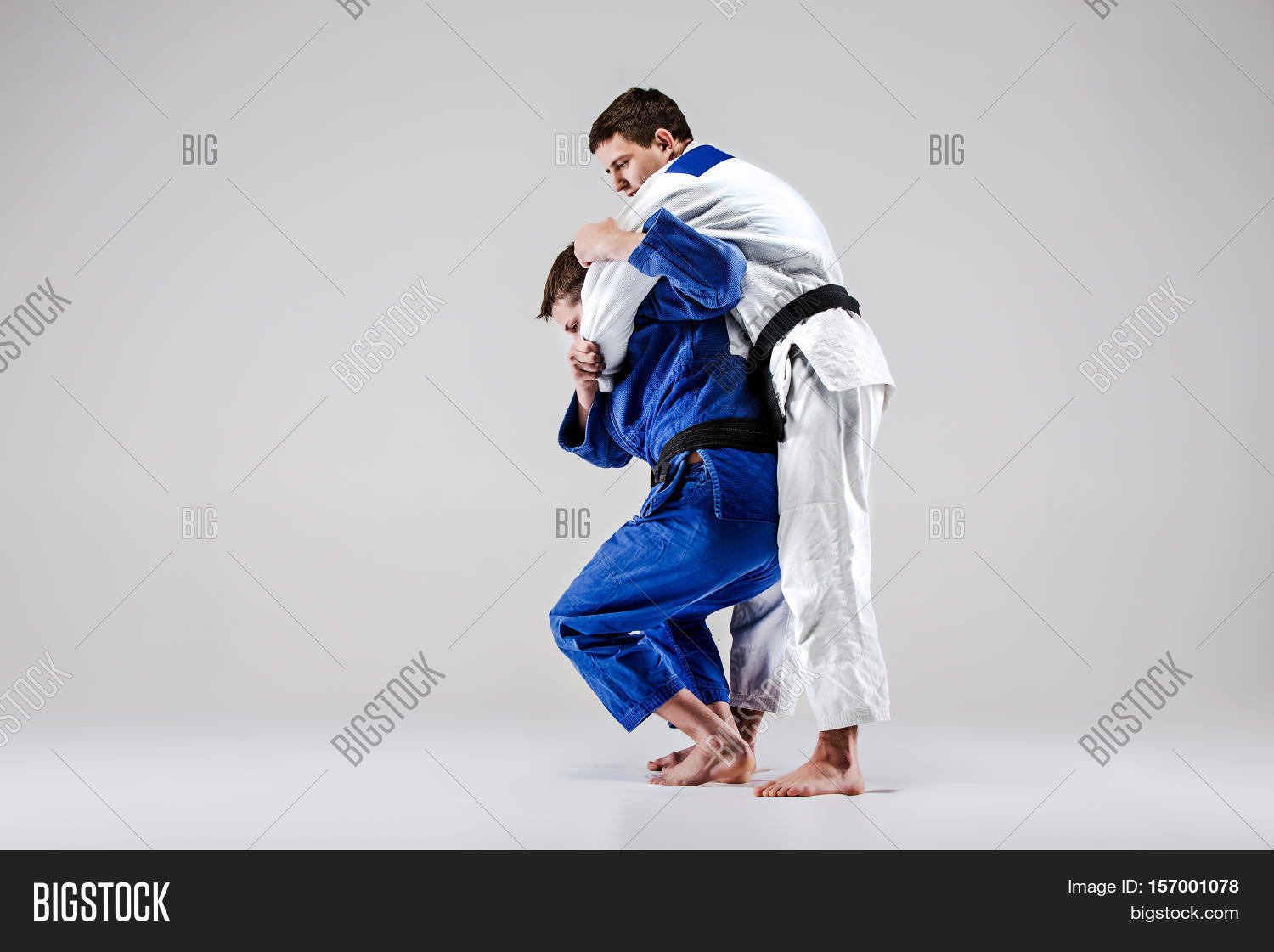 judo,martial,two,kimono,arts,fighting,competition,male,training,men,sports,adult,karate,man,people,length,full,caucasian,combat,indoors,judokas,fighters,oppositions,active,athlete,exercise,fight,fitness,gym,healthy,judogi,lifestyle,practice,skill,strength,strong,young,action,aikido,agility,bout,boxing,club,studio,gray,throw,capture