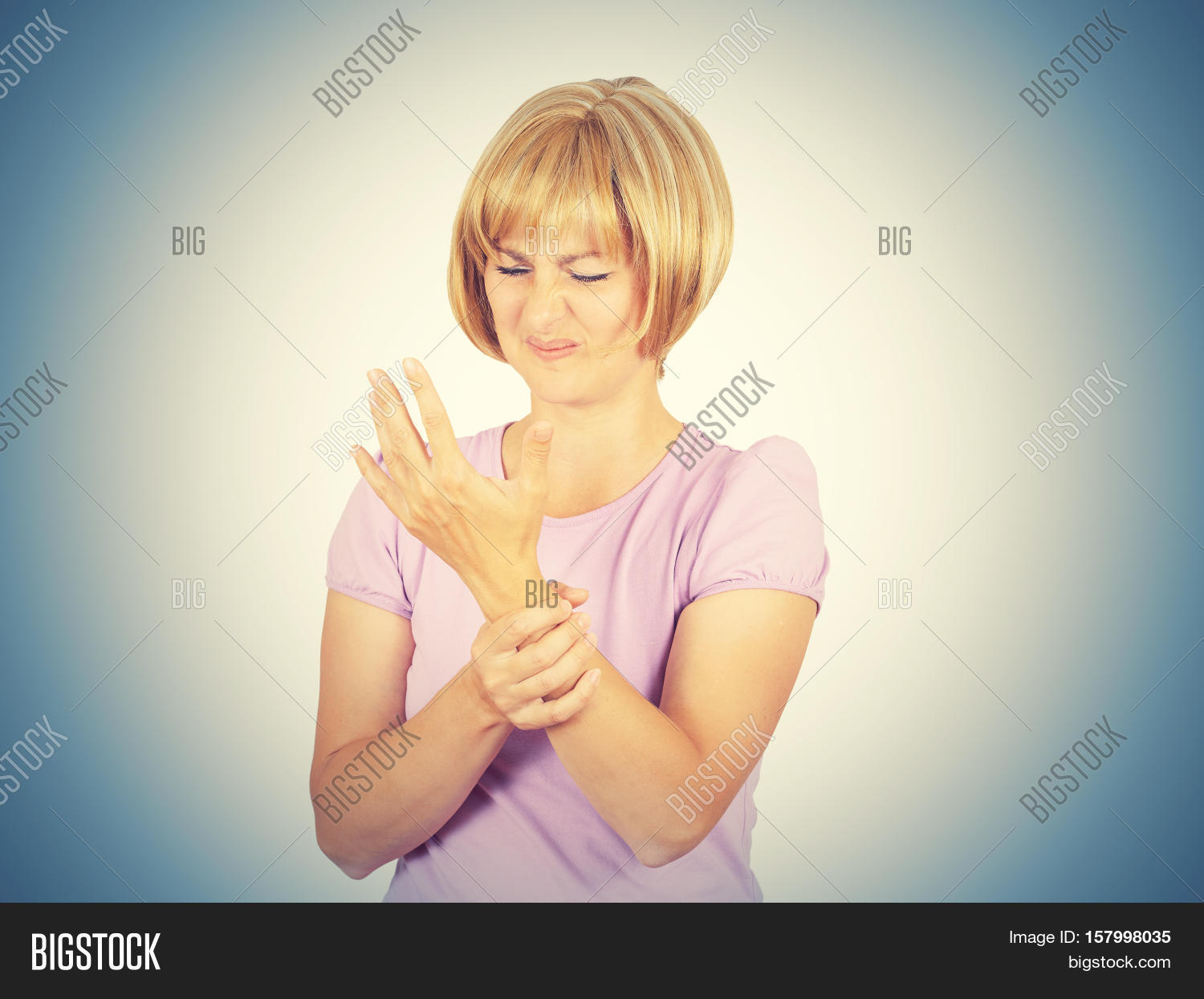 Close-up Portrait Young Woman Holding Her Painful Wrist Isolated On Background.