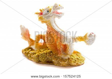 feng shui golden chinese dragon of the lucky sculpture isolated on white background stock photo