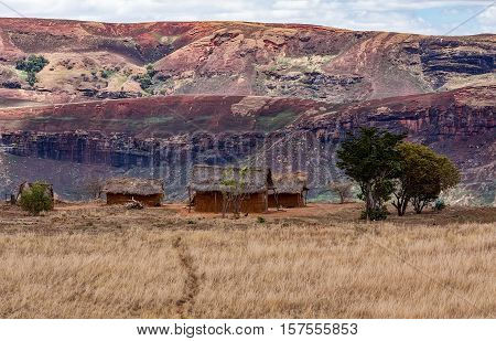 Traditional Madagascar hill landscape with malagasy huts. Deforestation in Madagascar creates agricultural or pastoral land but can also result ecology problem with soil and water. Mahajanga Province Madagascar stock photo