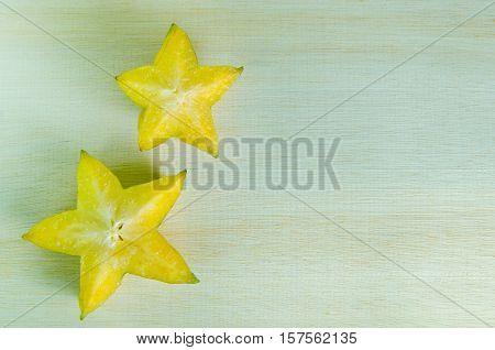 Star apple fruit (Also known as Carambola starfruit Averrhoa apple carambola Bilimbi Arkin in Florida Dah Pon Ma fueng Demak Golden Star Star King Golden star) with blank copy text space stock photo