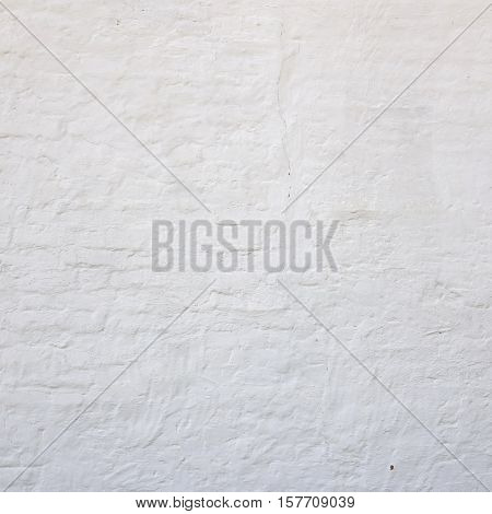Abstract Rectangular White Texture. White Washed Old Brick Wall With Stained And Shabby Uneven Plaster. Painted White Grey Brickwall Square Background. Home House Room Interior Design. stock photo