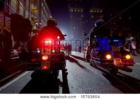 Two Police Officers On Motorcycles In A Night City. stock photo