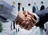 success concept in business - handshake of business partners