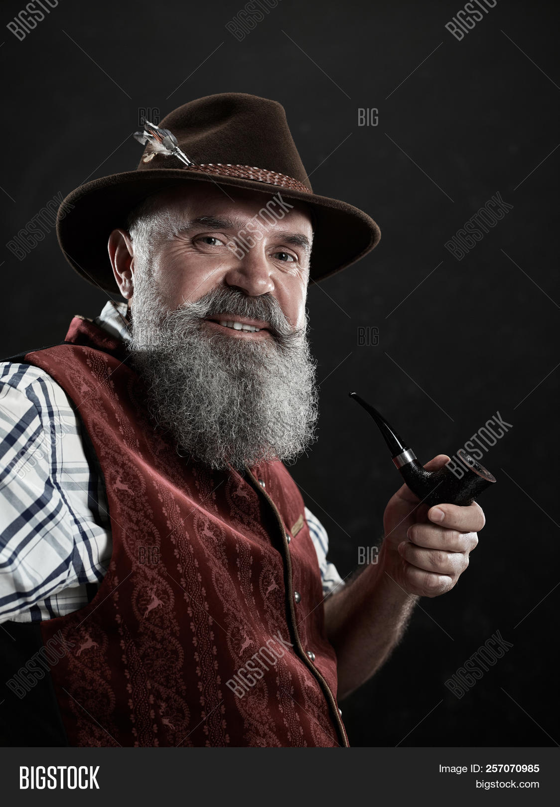 Austrian,Bavaria,Bavarian,German,Tyrolean,adult,aged,background,bald,beard,black,blazer,cap,caucasian,concerned,costume,darkness,elderly,european,expression,face,facial,feather,habit,hat,human,intelligent,male,man,mature,national,old,one,pensive,people,person,pipe,portrait,profile,senior,shirt,single,smile,smiling,smoke,thoughtful,tobacco,traditional,waistcoat,white