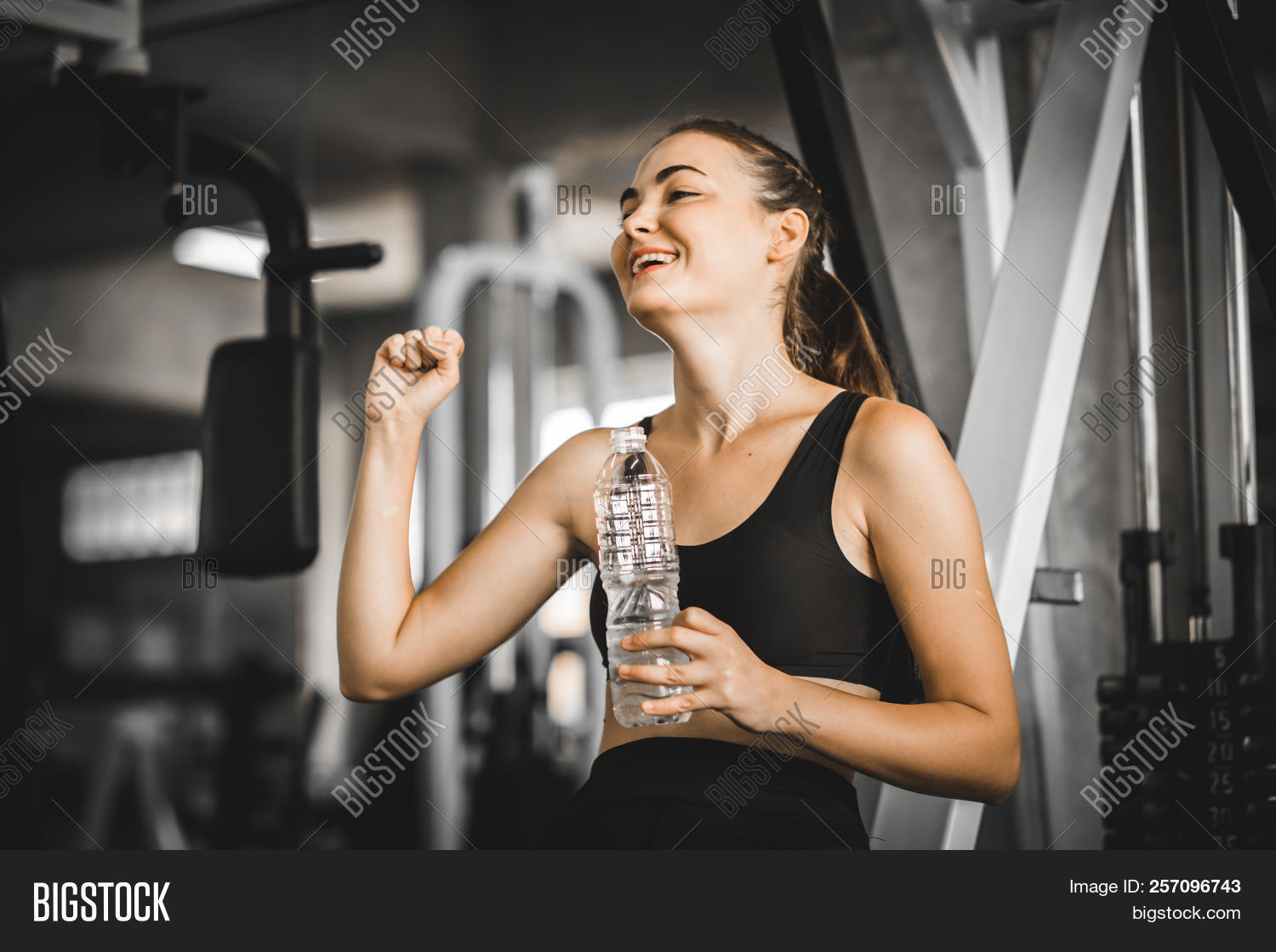 Fit Young Woman Caucasian Sitting And Resting After Workout Or Exercise In Fitness Gym. Woman At Gym