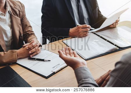 Business Man Explaining About His Profile To Two Senior Manager Sitting In During Job Interview, Int