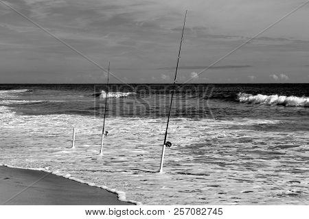 Surf Fishing poles on the ocean beach at Florida, USA stock photo